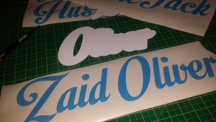 Contour-cut alu-comp personalised name plaque with cut vinyl. Exclusive design limitations apply